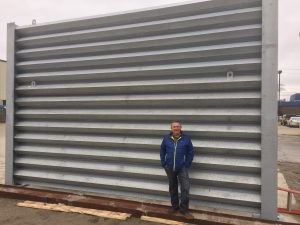 Ideal Utility Services owner, Frank Venegas, with the ballistic barrier in Detroit, MI